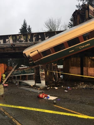 A handout photo from the Washington State Patrol shows Amtrak train 501, which derailed onto Interstate 5.