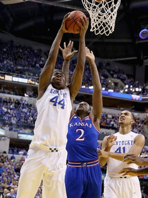 INDIANAPOLIS, IN - NOVEMBER 18:  Dakari Johnson #44 of the Kentucky Wildcats shoots the ball during the game against the Kansas Jayhwaks in the State Farm Champions Classic at Bankers Life Fieldhouse on November 18, 2014 in Indianapolis, Indiana.  (Photo by Andy Lyons/Getty Images)