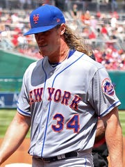 Mets starting pitcher Noah Syndergaard (34) walks off the field after an apparent injury against the Washington Nationals in the second inning at Nationals Park.