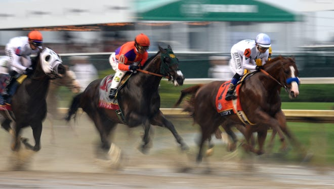 Justify, ridden by Mike Smith, and the rest of the pack as the pass in front of the grandstands on the first pass of the 144th Kentucky Derby. May 5, 2018