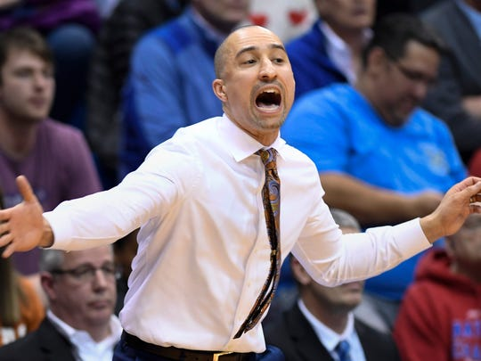 Texas head coach Shaka Smart yells to his team during the first half of their NCAA college basketball game against Kansas in Lawrence, Kan., Monday, Feb. 3, 2020. (AP Photo/Reed Hoffmann)