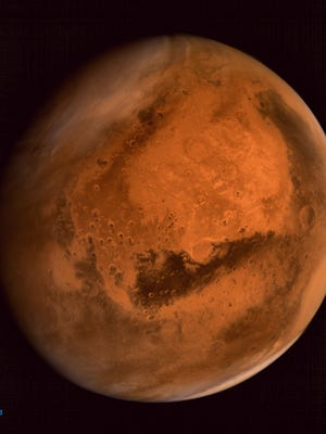 Mars as seen on Sept. 30, 2014, in an image taken by the Indian Space Research Organisation Mars Orbiter Mission (MOM) spacecraft.