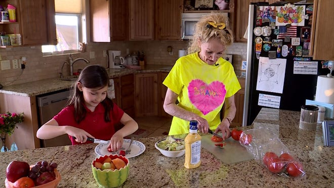 Rebecca Hurst makes a healthy lunch with her granddaughter.