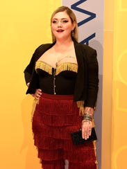 Elle King arrives on the red carpet at the 2016 CMA