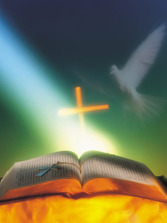 White dove appearing and light shining on Holy Bible