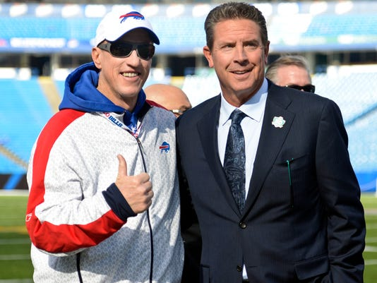 Former quarterbacks Jim Kelly, left, and Dan Marino pose for photographs before an NFL football game between the Buffalo Bills and the Miami Dolphins, Sunday, Nov. 8, 2015, in Orchard Park, N.Y. (AP Photo/Gary Wiepert)