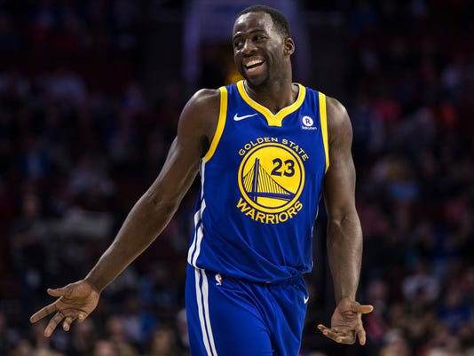 "In this Nov. 18, 2017, photo, Golden State Warriors' Draymond Green reacts during the second half of an NBA basketball game against the Philadelphia 76ers in Philadelphia. Green and Kevin Durant bet on just about anything. ""Life,"" Green explained, ""who drives home faster from the practice facility, who gets to the game earlier. You want us to tell you our whole life?"" KD and Dray have formed quite a bond since way back, when Green was part of the strategic recruiting process to bring Durant to the Bay Area from Oklahoma City before last season. (AP Photo/Chris Szagola, File)"