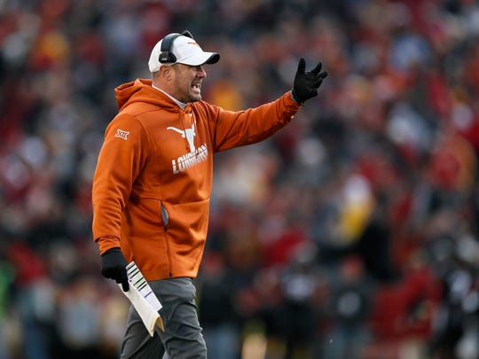 Texas head coach Tom Herman questions a call against his team during the first half of an NCAA college football game against Iowa State, Saturday, Nov. 16, 2019, in Ames, Iowa. Iowa State won 23-21. (AP Photo/Charlie Neibergall)