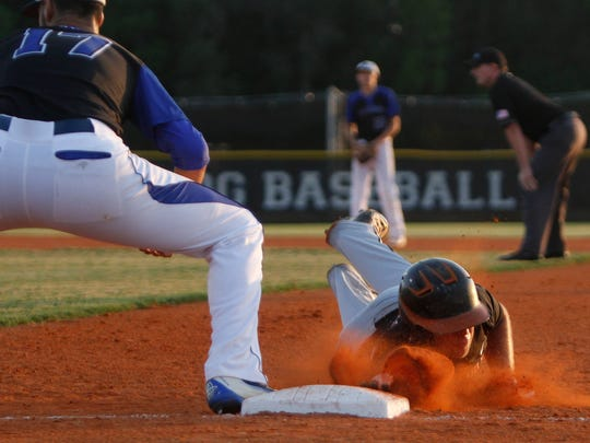 Lely's Christian Sanchez dives back to first base at the Region 6A-3 baseball quarterfinal against Ida Baker on Wednesday, April 27, 2016, in Cape Coral. (Sarah Coward/News-Press)