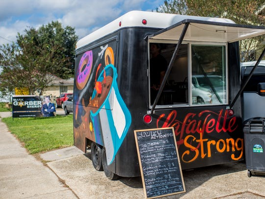 The Live Action Deli food truck is pictured during lunchtime near the UL campus on West St. Mary Street in , La., Wednesday, Nov. 11, 2015.
