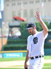 Tigers pitcher Justin Verlander waves to the cheering crowd when he exits the game after the top of the eighth inning.