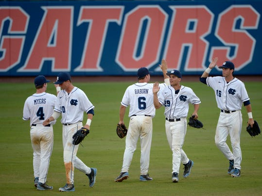 North Carolina players congratulate each other after defeating Florida 5-2 in an NCAA college baseball regional tournament game in Gainesville, Fla., Saturday, May 31, 2014.(AP Photo/Phelan M. Ebenhack)