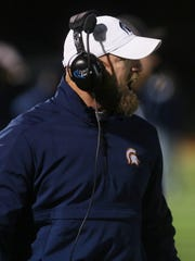 Summit headcoach Brian Coleman calls to his team during their game against Page at Summit High School Friday November 10, 2017.
