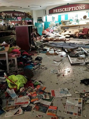 The interior of Jackson Discount Pharmacy after a car drove into the store Saturday May 9, 2015.