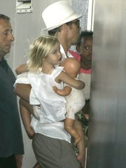 U.S. actor Brad Pitt arrives at the Lenval Hospital in Nice, southern France, carrying his children Shiloh, in 2008, wasn't always obsessed with boyish things.  She is shown carrying a doll.