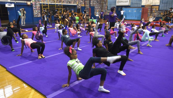 Detroit children having gymnastics lessons as part of an open house kicking off a new youth gymnastics program sponsored by the Wendy Hilliard Gymnastics Foundation on Saturday.
