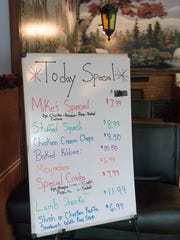 Walk in to Tasty Kabob and you're greeted by a large board with the day's specials.