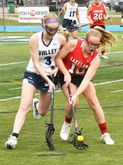 Lakeland's Devyn Tanajewski, right, scored two goals in the Lancers' first-round victory over DePaul.