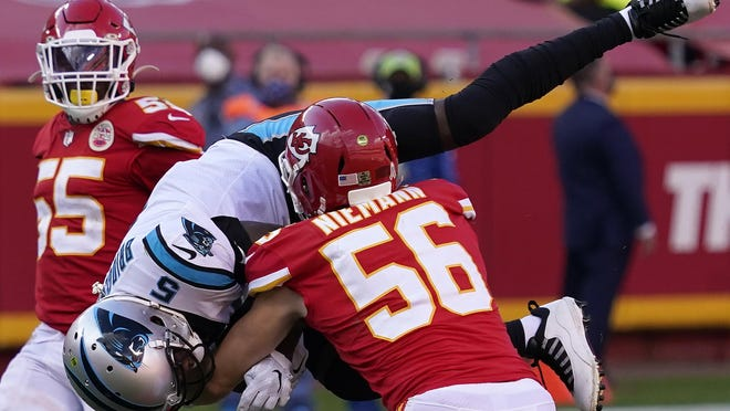 Panthers quarterback Teddy Bridgewater (5) is tackled by Chiefs linebacker Ben Niemann (56) on Sunday in Kansas City, Mo.