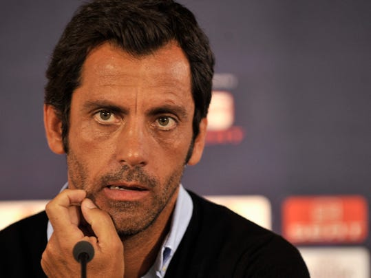 FILE - In this Wednesday Sept. 15, 2010 file photo, Atletico's head coach Quique Sanchez Flores attends a news conference at the Kleanthis Vikelidis stadium in Thessaloniki, Greece. Quique Sanchez Flores will stay as coach of Spanish team Espanyol following interest in him from English club Stoke City. (AP Photo/Nikolas Giakoumidis, File)