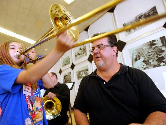 Ashtyn Wilkinson, 9, plays a trombone as Hardin-Simmons