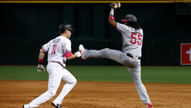 Pittsburgh Pirates' Josh Bell (55) makes a catch at first base to get Arizona Diamondbacks' A.J. Pollock (11) out during the sixth inning of a baseball game Sunday, May 14, 2017, in Phoenix. The Pirates defeated the Diamondbacks 6-4.