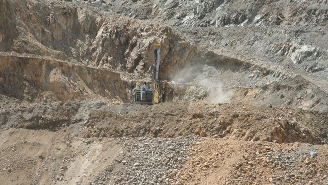 A rig works on the Lucerne Pit, the main pit being mined by Comstock Mining Inc. near Silver City.