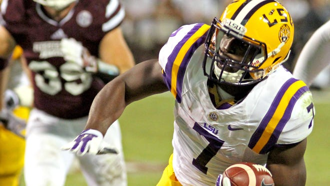 LSU running back Leonard Fournette (7) rushes past Mississippi State defender Ritchie Brown (39) on his way to a touchdown during the first half of the NCAA college football game in Starkville, Miss., Saturday, Sept. 12, 2015. (AP Photo/Jim Lytle)