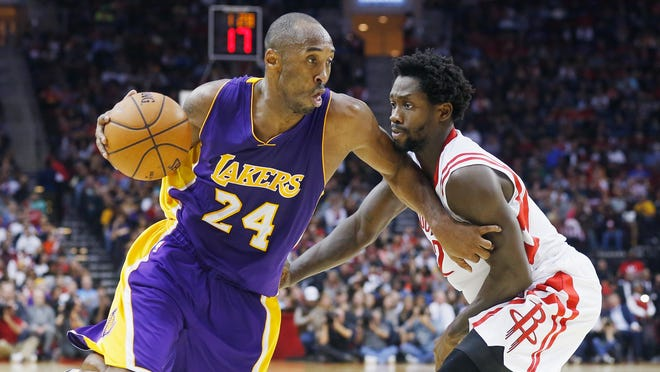 HOUSTON, TX - NOVEMBER 19: Kobe Bryant #24 of the Los Angeles Lakers drives with the ball against Patrick Beverley #2 of the Houston Rockets during their game at the Toyota Center on November 19, 2014 in Houston, Texas. NOTE TO USER: User expressly acknowledges and agrees that, by downloading and/or using this photograph, user is consenting to the terms and conditions of the Getty Images License Agreement. (Photo by Scott Halleran/Getty Images)