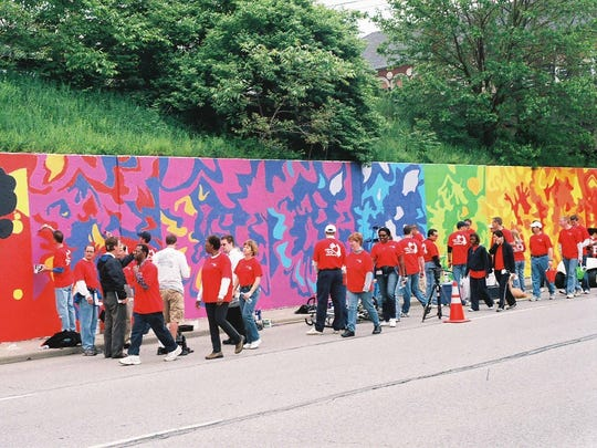 The mural along Madison Avenue for Eli Lilly's first Day of Service, which earned a Guinness World Record for the largest painting by numbers mural.