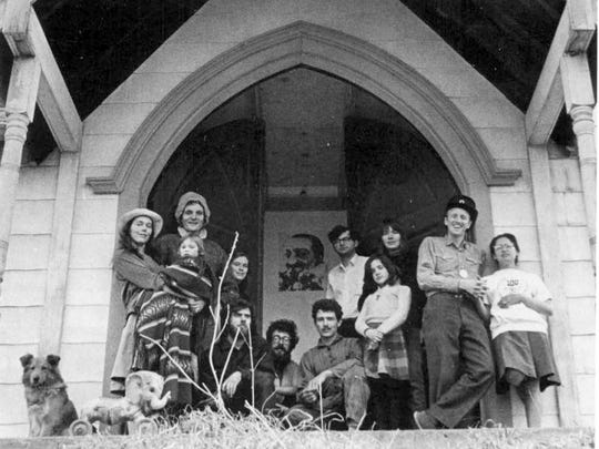 USCO and Friends at the Garnerville church, April 1966, from left: Barbara and Steve Durkee (holding Dakota), Judi Stern, photographer Christopher George, Gerd Stern (below Meher Baba poster, electronics technician Owen Jones, Michael Callahan, Gerd Stern's daughter Radha, philosopher-logician Jane Burton, Stewart and Lois Brand.