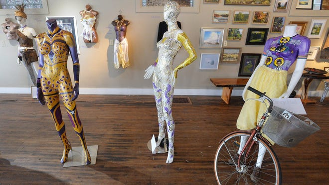 "Some of the 20 decorated mannequin art pieces assembled for ""Every Woman,"" a collaborative art project of Artlore Studio and the League of Women Voters Erie County Chapter, are displayed at Artlore Studio on Friday. The project is part of the 2020 Suffrage Centennial Project commemorating the 100th anniversary of the 19th Amendment. Each female artist used the colors white, gold and purple in their selected technique."