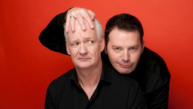 Colin Mochrie, left, and Brad Sherwood perform Sunday in Ames.