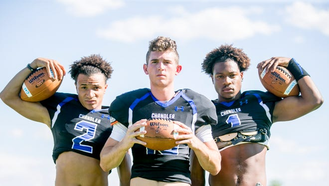 Chandlers' Chase Lucas (from left), Mason Moran and N'Keal Harry pose for portraits at Chandler High School on July 27, 2015.