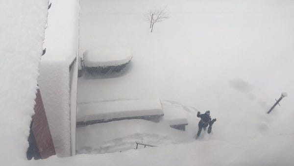 """Photographer Shawn Dowd: """"Deep heavy snow greets us this morning in Rochester. Very slow going."""""""
