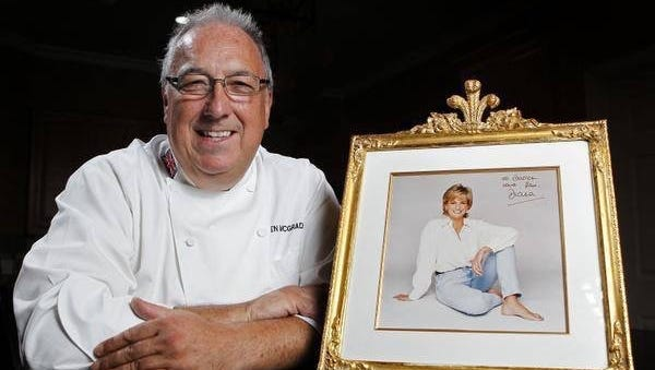 Darren McGrady, Princess Diana's former personal chef, poses with a portrait of her.