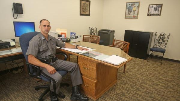 Captain Richard Mazzone, commanding officer for Troop T, Zone 1 for the New York State Police, in his office at the new temporary New York State Police barracks in West Nyack, photographed Aug. 7, 2014. The state police have moved their Troop T, Zone 1 headquarters from Tarrytown to West Nyack for the duration of the construction of the replacement for the Tappan Zee Bridge. The new headquarters, located on route 303 in West Nyack, is located in a building that formerly housed a Journal News printing plant.