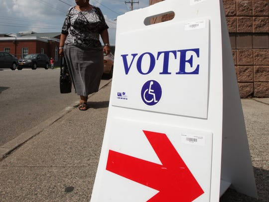 A voter heads to the polls during the East Ramapo school