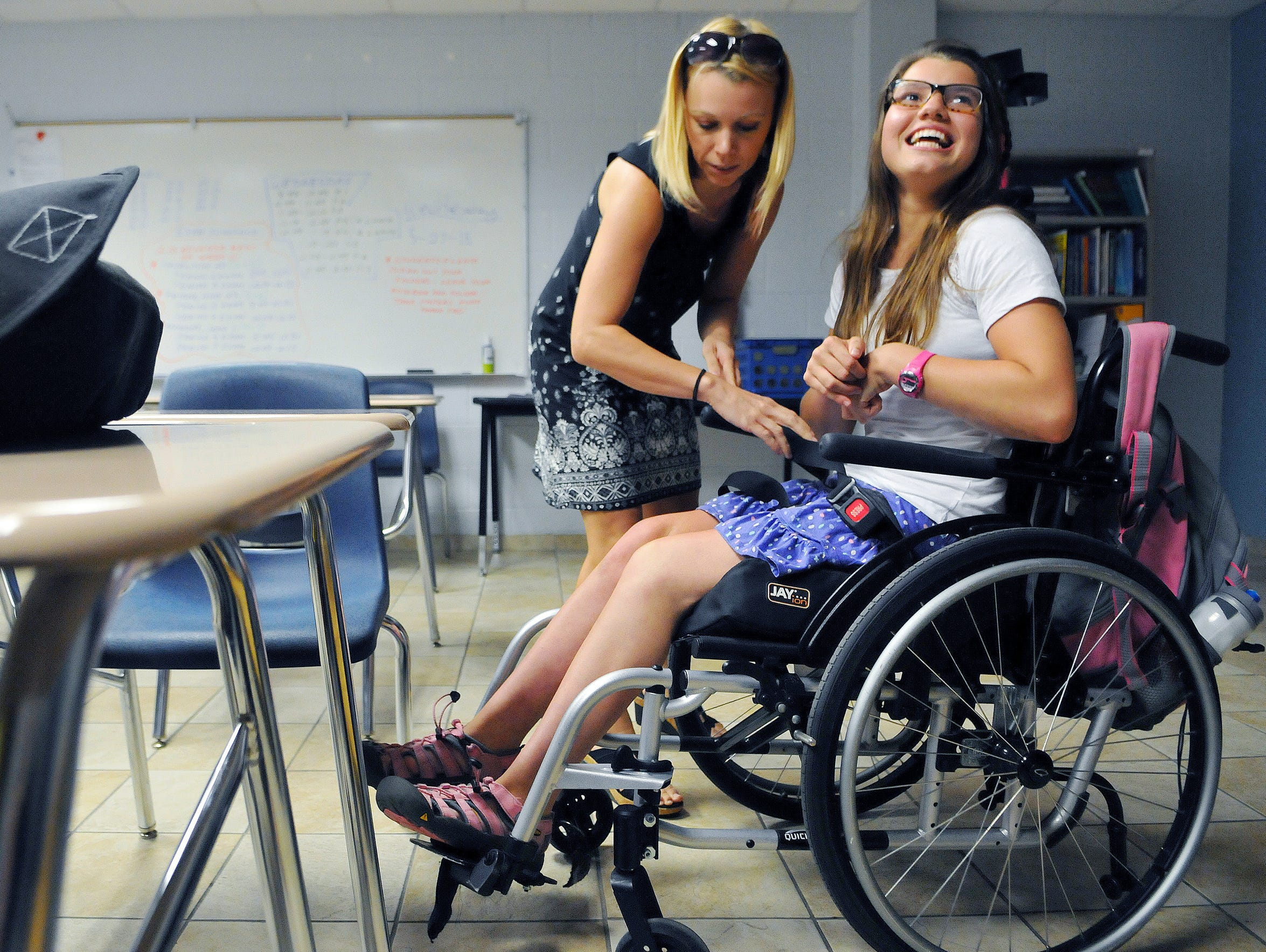 Jacqueline Eaton, an instructional assistant, helps
