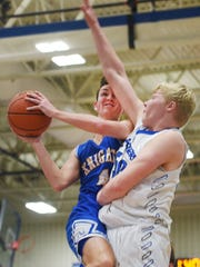 O'Gorman's Michael Statz pushes past Sioux Falls Christian's Zach Witte during the game Tuesday, Jan. 2, at O'Gorman.