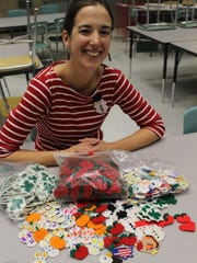 State Road Elementary School art teacher Kelly Stevens with some of the hundreds of pins her grandmother made.