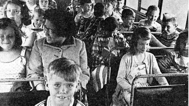 Shirley Bulah rides to school on a once-segregated Delaware bus in this 1954 photo.