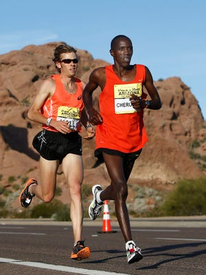 Benson Cheruiyot (right) edges Ryan Hall by a second, 1:04:14 to 1:04:15 for the win at the P.F. Chang's Rock 'n' Roll Arizona Half Marathon on Jan. 18, 2015 in Phoenix.