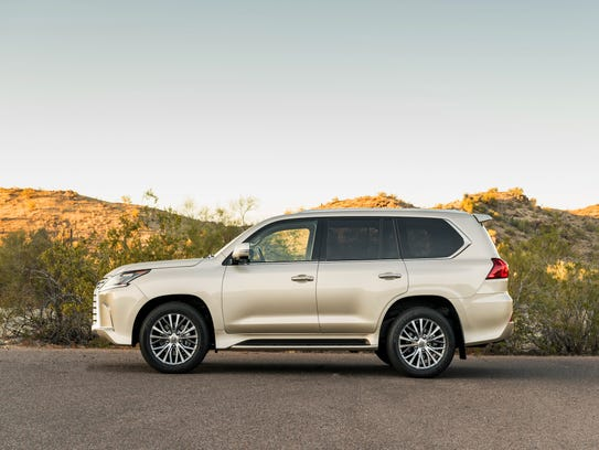From the side, the Lexus LX 570 shows its stature