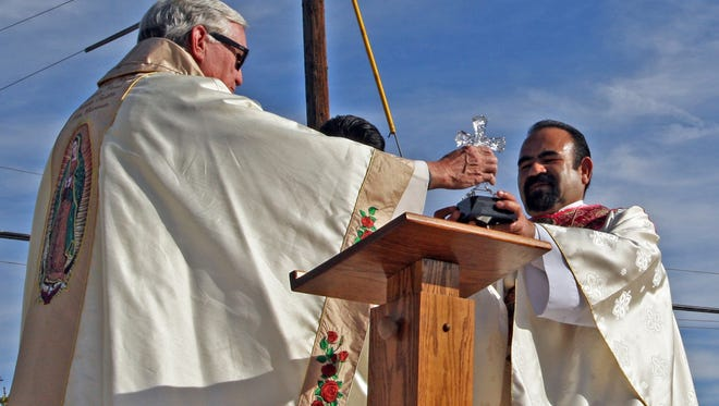 Fr. Wall presents Pastor Enrique Herrera with the Light of Christ award