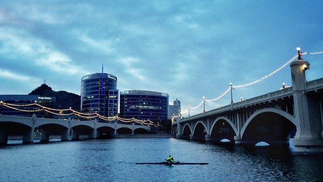 Tempe Town Lake Rowing Club member Mike Shelton goes for an early morning scull on the first day of winter, Dec. 22, 2015, at Tempe Town Lake.