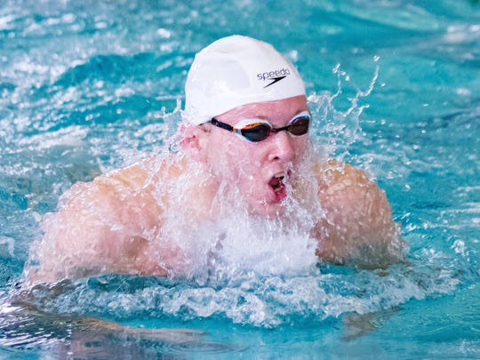 South Lyon Unified's Brandon Bell figured in three firsts, including the 100-yard breaststroke, at the Lakes Valley Conference meet.