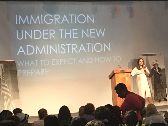 Indera DeMine, an immigration attorney, addresses women Saturday at Sidney & Berne Davis Art Center in Fort Myers.