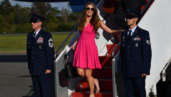 White House Communications Director Hope Hicks walks down the stairs after President Trump disembarked from Air Force One at Morristown Municipal Airport on Sept. 29, 2017, in Morristown, N.J.