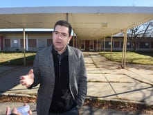 Dr. Malaz Alatassi stands outside the former Franklin Elementary School in Pontiac. Alatassi and a group of investors have invested in building housing for Syrian refugees. He remains hopeful even while City and County officials are now opposed to the project.
